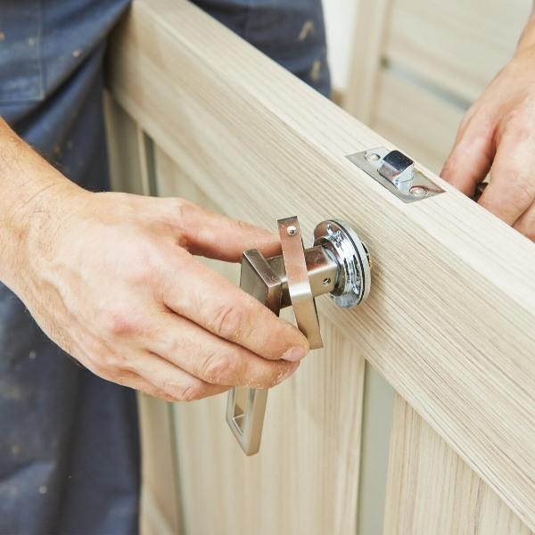 Man Installing Door Knob